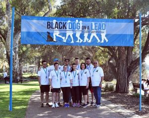 march for mates, black dog on a lead
